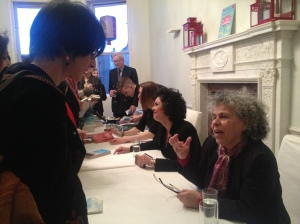 The panellists talk to audience members and sign books after the event [My photo]